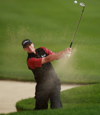 DOHA, QATAR - FEBRUARY 03:  Steve Stricker of the USA plays a bunker shot on the 18th hole during the first round of the Commercialbank Qatar Masters held at Doha Golf Club on February 3, 2011 in Doha, Qatar.  (Photo by Andrew Redington/Getty Images)