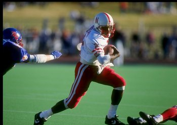 10 Nov 1990:  Mickey Joseph of the Nebraska Cornhuskers runs with the ball during a game against the Kansas Jayhawks.  Nebraska won the game 41-9. Mandatory Credit: Tim de Frisco  /Allsport