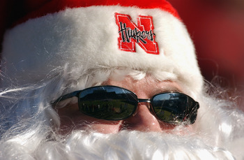 SHREVEPORT, LA - DECEMBER 27:  Husker fans wears a Santa outfit along with sun glasses during the MainStay Independence Bowl game between the University of Mississippi Ole Miss Rebels and the University of Nebraska Huskers at Independence Stadium on Decem