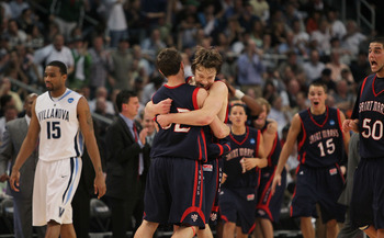 PROVIDENCE, RI - MARCH 20:  Mickey McConnell #32 is hugged by Matthew Dellavedova #4 of the Saint Mary's Gaels after a win over the Villanova Wildcats during the second round of the 2010 NCAA men's tournament at Dunkin' Donuts Center on March 20, 2010 in