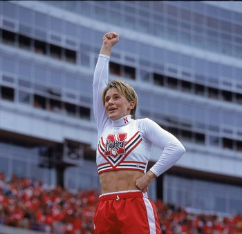 23 Sep 2000: A cheerleader of the Nebraska Cornhuskers cheers on the field as she is lifted into the air during a game against the Iowa Hawkeyes at the Memorial Stadium in Lincoln, Nebraska. The Cornhuskers defeated the Hawkeyes 42-13.Mandatory Credit: Br