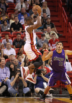MIAMI, FL - FEBRUARY 22:  Dwyane Wade #3 of the Miami Heat looks to pass during a game against the Sacramento Kings at American Airlines Arena on February 22, 2011 in Miami, Florida. NOTE TO USER: User expressly acknowledges and agrees that, by downloadin