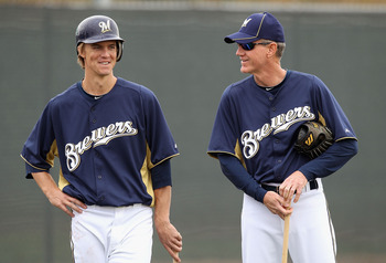 PHOENIX, AZ - FEBRUARY 18:  (L-R) Zack Greinke #13 and manager Ron Roenicke #10 of the Milwaukee Brewers talk during a MLB spring training practice at Maryvale Baseball Park on February 18, 2011 in Phoenix, Arizona.  (Photo by Christian Petersen/Getty Ima