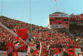 29 Oct 1994:  University of Nebraska fans celebrate by climbing the goalpost prior to the Cornhuskers 24-7 win over the University of Colorado at Memorial Stadium in Lincoln, Nebraska. Mandatory Credit: Todd Rosenberg/ALLSPORT