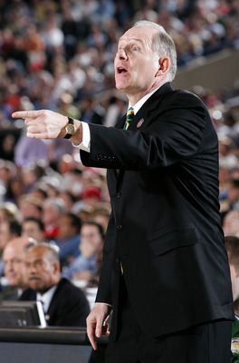 INDIANAPOLIS - APRIL 01: Head coach Jim Larranaga of the George Mason Patriots points against the Florida Gators during the semifinal game of the NCAA Men's Final Four on April 1, 2006 at the RCA Dome in Indianapolis, Indiana. The Gators defeated the Patr