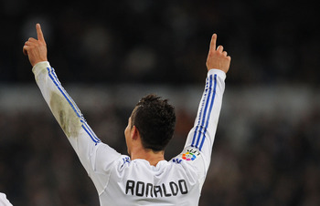 MADRID, SPAIN - JANUARY 09:  Cristiano Ronaldo of  Real Madrid celebrates after scoring Real's third goal during the La Liga match between Real Madrid and Villarreal at Estadio Santiago Bernabeu on January 9, 2011 in Madrid, Spain.  (Photo by Denis Doyle/