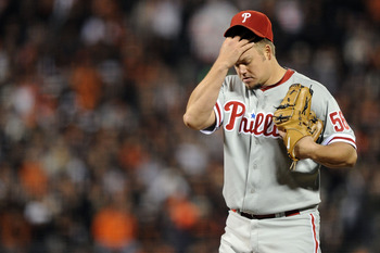 SAN FRANCISCO - OCTOBER 20:  Joe Blanton #56 of the Philadelphia Phillies reacts in the fifth inning of Game Four of the NLCS against the San Francisco Giants during the 2010 MLB Playoffs at AT&T Park on October 20, 2010 in San Francisco, California.  (Ph