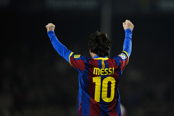 BARCELONA, SPAIN - FEBRUARY 05:  Lionel Messi of Barcelona celebrates after scoring his team's second goal during the La Liga match between Barcelona and Atletico de Madrid at Camp Nou on February 5, 2011 in Barcelona, Spain.  (Photo by David Ramos/Getty