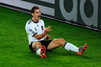 DURBAN, SOUTH AFRICA - JUNE 13:  Miroslav Klose of Germany celebrates after he scores his side's second goal during the 2010 FIFA World Cup South Africa Group D match between Germany and Australia at Durban Stadium on June 13, 2010 in Durban, South Africa