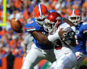 GAINESVILLE, FL - OCTOBER 17: Running back Dennis Johnson #33  of the Arkansas Razorbacks fumbles in the first quarter against the Florida Gators October 17, 2009 at Ben Hill Griffin Stadium in Gainesville, Florida.  (Photo by Al Messerschmidt/Getty Image