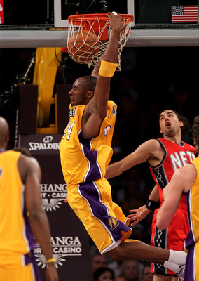 LOS ANGELES, CA - JANUARY 14:  Kobe Bryant #24 of the Los Angeles Lakers dunks over Sasha Vujacic #20 of the New Jersey Nets at Staples Center on January 14, 2011 in Los Angeles, California. The Lakers won 100-88.  NOTE TO USER: User expressly acknowledge