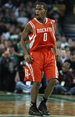 BOSTON, MA - JANUARY 10:  Aaron Brooks #0 of the Houston Rockets celebrates his three point shot in the second half against the Boston Celtics on January 10, 2011 at the TD Garden in Boston, Massachusetts.  The Rockets defeated the Celtics 108-102. NOTE T