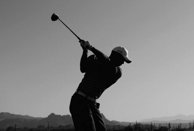 MARANA, AZ - FEBRUARY 22: (EDITORS NOTE: THIS BLACK AND WHITE IMAGE WAS CREATED FROM ORIGINAL COLOUR FILE). Tiger Woods hits a shot on the driving range during practice prior to the start of the World Golf Championships-Accenture Match Play Championship h