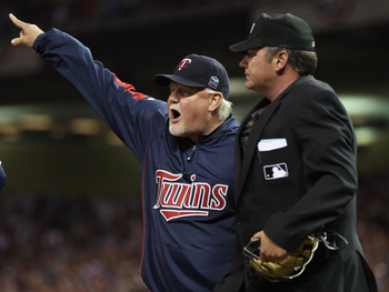 MINNEAPOLIS - OCTOBER 07:  Manager Ron Gardenhire #35 of the Minnesota Twins is ejected from the game by Hunter Wedelstedt in the seventh inning against the New York Yankees during game two of the ALDS on October 7, 2010 at Target Field in Minneapolis, Mi