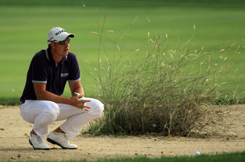 DUBAI, UNITED ARAB EMIRATES - FEBRUARY 11:  Henrik Stenson of Sweden plays his second shot at the par 4, 16th hole during the second round of the 2011 Omega Dubai Desert Classic on the Majilis Course at the Emirates Golf Club on February 11, 2011 in Dubai
