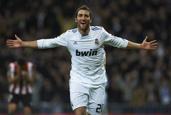 MADRID, SPAIN - NOVEMBER 20:  Gonzalo Higuain of Real Madrid celebrates after scoring the 1-0 during the la liga match between Real Madrid and Athletic Bilbao at Estadio Santiago Bernabeu on November 20, 2010 in Madrid, Spain.  (Photo by Manuel Queimadelo