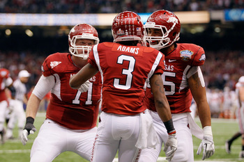 NEW ORLEANS, LA - JANUARY 04:  Joe Adams #3 of the Arkansas Razorbacks reacts with teammates Wade Grayson #71 and D.J. Williams #45 after Adams' catches a 17-yard touchdown pass in the endzone against Travis Howard #18 of the Ohio State Buckeyes in the fi