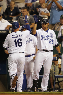 KANSAS CITY, MO - AUGUST 13:  Billy Butler #16 of the Kansas City Royals is congratulated by teammates after hitting a home run during the 5th inning of the game against the New York Yankees on August 13, 2010 at Kauffman Stadium in Kansas City, Missouri.