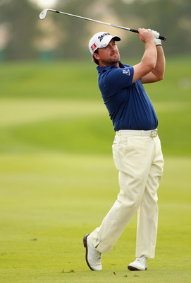 ABU DHABI, UNITED ARAB EMIRATES - JANUARY 22:  Graeme McDowell of Northern Ireland in action during the third round of The Abu Dhabi HSBC Golf Championship at Abu Dhabi Golf Club on January 22, 2011 in Abu Dhabi, United Arab Emirates.  (Photo by Andrew Re