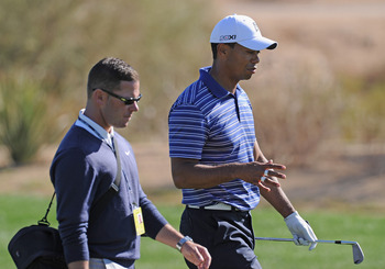 MARANA, AZ - FEBRUARY 22:  Tiger Woods talks with coach Sean Foley during practice prior to the start of the World Golf Championships-Accenture Match Play Championship held at The Ritz-Carlton Golf Club, Dove Mountain on February 22, 2011 in Marana, Arizo