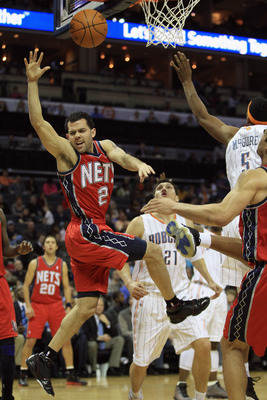 CHARLOTTE, NC - FEBRUARY 11:  Jordan Farmar #2 of the New Jersey Nets is fouled against the Charlotte Bobcats during their game at Time Warner Cable Arena on February 11, 2011 in Charlotte, North Carolina. NOTE TO USER: User expressly acknowledges and agr