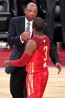 LOS ANGELES, CA - FEBRUARY 20:  Head coach Doc Rivers shakes hands with Chris Paul #3 of the New Orleans Hornets and the Western Conference after the 2011 NBA All-Star Game at Staples Center on February 20, 2011 in Los Angeles, California. NOTE TO USER: U