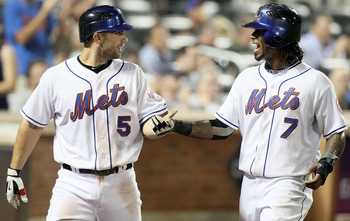 NEW YORK - JULY 06:  Jose Reyes #7 and David Wright #5 of the New York Mets celebrate after scoring in the sixth inning against the Cincinnati Reds on July 6, 2010 at Citi Field in the Flushing neighborhood of the Queens borough of New York City.  (Photo