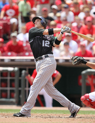 CINCINNATI - JULY 18:  Clint Barmes #12  of the Colorado Rockies is at bat during the game against the Cincinnati Reds at Great American Ball Park on July 18, 2010 in Cincinnati, Ohio.  (Photo by Andy Lyons/Getty Images)
