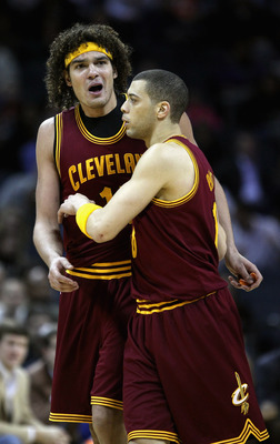 CHARLOTTE, NC - DECEMBER 29:  Anthony Parker #18 of the Cleveland Cavaliers holds back teammate Anderson Varejao after he was called for a technical foul against the Charlotte Bobcats during their game at Time Warner Cable Arena on December 29, 2010 in Ch