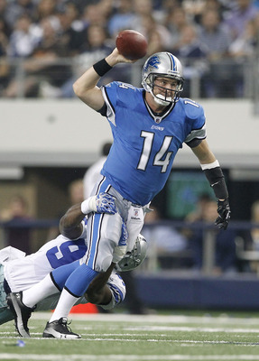 ARLINGTON, TX - NOVEMBER 21: Shaun Hill #14 of the Detroit Lions throws the ball as DeMarcus Ware #94 of the Dallas Cowboys makes the sack during the game at Dallas Stadium on November 21, 2010 in Arlington, Texas. The Cowboys defeated the Lions 35-19.  (