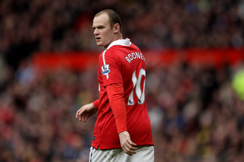 MANCHESTER, ENGLAND - FEBRUARY 12:  Wayne Rooney of Manchester United reacts during the Barclays Premier League match between Manchester United and Manchester City at Old Trafford on February 12, 2011 in Manchester, England.  (Photo by Alex Livesey/Getty