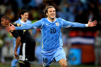 PORT ELIZABETH, SOUTH AFRICA - JULY 10:  Diego Forlan of Uruguay celebrates scoring his team's second goal during the 2010 FIFA World Cup South Africa Third Place Play-off match between Uruguay and Germany at The Nelson Mandela Bay Stadium on July 10, 201