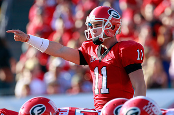 JACKSONVILLE, FL - OCTOBER 30:  Quarterback Aaron Murray of the Georgia Bulldogs points during the game against the Florida Gators at EverBank Field on October 30, 2010 in Jacksonville, Florida.  (Photo by Sam Greenwood/Getty Images)