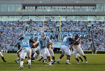 CHAPEL HILL, NC - NOVEMBER 13:  T.J. Yates #13 of the North Carolina Tar Heels against the Virginia Tech Hokies during their game at Kenan Stadium on November 13, 2010 in Chapel Hill, North Carolina.  (Photo by Streeter Lecka/Getty Images)
