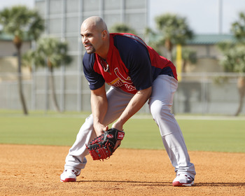 JUPITER, FL - FEBRUARY 17: Albert Pujols #5 of the St. Louis Cardinals fields balls during infield practice at Roger Dean Stadium on February 17, 2011 in Jupiter, Florida. (Photo by Joel Auerbach/Getty Images)