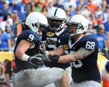 TAMPA, FL - JANUARY 1:  Running back Michael Zordich #9 of the Penn State Nittany Lions celebrates a score with center Doug Klopacz #68 against the Florida Gators January 1, 2010 in the 25th Outback Bowl at Raymond James Stadium in Tampa, Florida.  (Photo