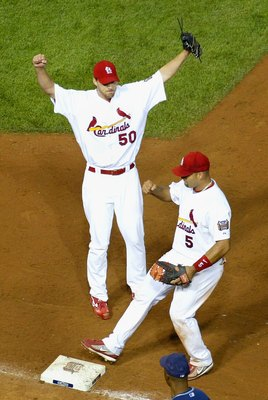 ST. LOUIS - OCTOBER 08:  Releif pitcher Adam Wainwright #50 and Albert Pujols #5 of the St. Louis Cardinals celebrate after defeating the San Diego Padres in Game Four of the National League Division Series at Busch Stadium on October 8, 2006 in St. Louis