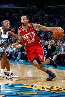 NEW ORLEANS, LA - DECEMBER 22:  Devin Harris #34 of the New Jersey Nets drives the ball around Jarrett Jack #2  of the New Orleans Hornets at the New Orleans Arena on December 22, 2010 in New Orleans, Louisiana.    The Hornets defeated the Nets 105-91.