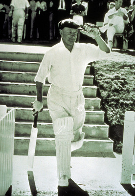 3 Feb 1963: Sir Donald Bradman of Australia walks toward the wicket while playing for PM XI in Canberra, Australia. Mandatory Credit: Allsport Australia/ALLSPORT