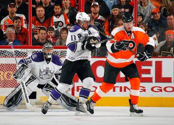 PHILADELPHIA - FEBRUARY 13:  Anze Kopitar #11 of the Los Angeles Kings blocks a shot while battling for position with Jeff Carter #17 of the Philadelphia Flyers on February 13, 2011 at the Wells Fargo Center in Philadelphia, Pennsylvania.  (Photo by Lou C