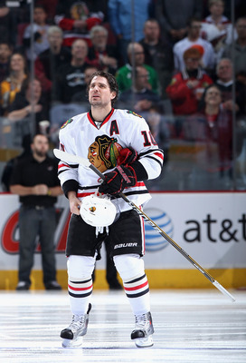 GLENDALE, AZ - FEBRUARY 12:  Patrick Sharp #10 of the Chicago Blackhawks stands attended for the National Anthem before the NHL game against the Phoenix Coyotes at Jobing.com Arena on February 12, 2011 in Glendale, Arizona.  The Coyotes defeated the Black