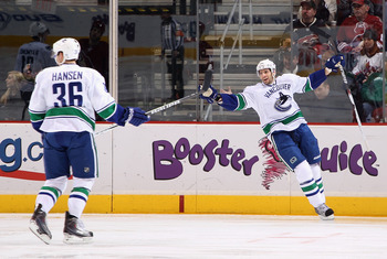 GLENDALE, AZ - FEBRUARY 02:  Jannik Hansen #36 and Ryan Kesler #17 of the Vancouver Canucks celebrate after Hansen scored a second period goal against the Phoenix Coyotes during the NHL game at Jobing.com Arena on February 2, 2011 in Glendale, Arizona.  (