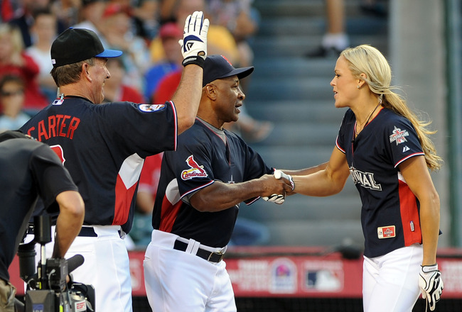 ANAHEIM, CA - JULY 11:  Former MLB player Gary Carter and former MLB player Ozzie Smith congratulate Softball Olympic gold medalist Jennie Finch after she hit a home run during the MLB All Star Game Celebrity Softball Game at Angels Stadium of Anaheim on