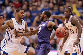 LAWRENCE, KS - JANUARY 29:  Jacob Pullen #0 of the Kansas State Wildcats controls the ball as Marcus Morris #22 of the Kansas Jayhawks defends during the game on January 29, 2011 at Allen Fieldhouse in Lawrence, Kansas.  (Photo by Jamie Squire/Getty Image