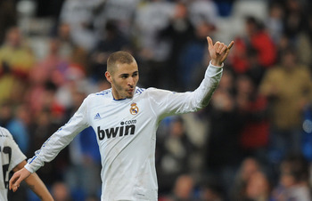 MADRID, SPAIN - DECEMBER 22:  Karim Benzema of Real Madrid celebrates after scoring his third goal against Levante in the first leg round of 16 Copa del Rey match between Real Madrid and Levante at Estadio Santiago Bernabeu on December 22, 2010 in Madrid,