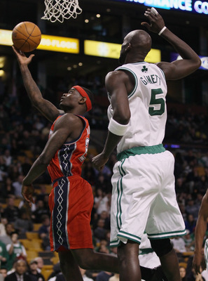BOSTON - NOVEMBER 24:  Anthony Morrow #22 of the New Jersey Nets takes a shot as Kevin Garnett #5 of the Boston Celtics defends on November 24, 2010 at the TD Garden in Boston, Massachusetts. The Celtics defeated the nets 89-83. NOTE TO USER: User express