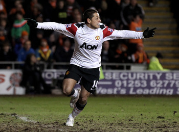 BLACKPOOL, ENGLAND - JANUARY 25:  Chicharito of Manchester United celebrates scoring his team's second goal during the Barclays Premier League match between Blackpool and Manchester United at Bloomfield Road on January 25, 2011 in Blackpool, England. (Pho