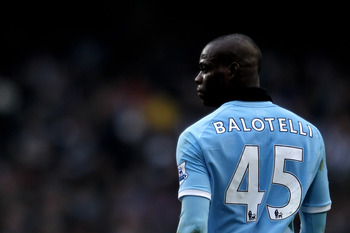MANCHESTER, ENGLAND - FEBRUARY 20:  Mario Balotelli of Manchester City looks on during the FA Cup sponsored by E.On 4th Round replay match between Manchester City and Notts County at City of Manchester Stadium on February 20, 2011 in Manchester, England.