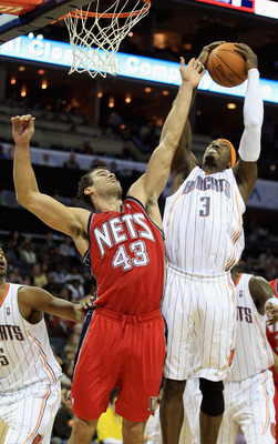 CHARLOTTE, NC - FEBRUARY 11:  Kris Humphries #43 of the New Jersey Nets battles for a rebound with Gerald Wallace #3 of the Charlotte Bobcats during their game at Time Warner Cable Arena on February 11, 2011 in Charlotte, North Carolina. NOTE TO USER: Use