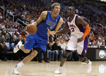 PHOENIX, AZ - FEBRUARY 17:  Dirk Nowitzki #41 of the Dallas Mavericks drives the ball past Mickael Pietrus #12 of the Phoenix Suns during the NBA game at US Airways Center on February 17, 2011 in Phoenix, Arizona. The Mavericks defeated the Suns 112-106.